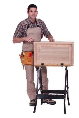 woodworker: woodworker making a window