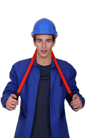 long neck: Worker carrying a pair of pliers behind his neck Stock Photo