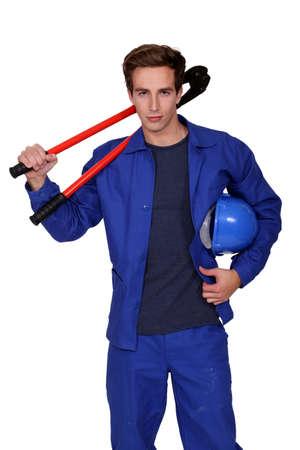 oversized: Tradesman holding oversized pliers