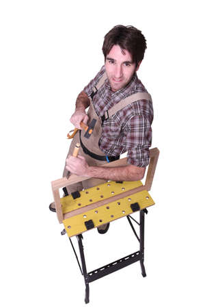 gouge: Man using hammer and chisel Stock Photo