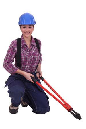 Woman holding bolt cutter Stock Photo - 15573419