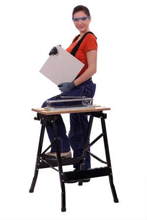 a handywoman showing a tile Stock Photo - 15573317