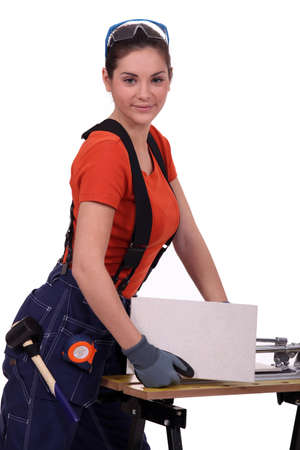 Woman cutting tile Stock Photo - 15573862