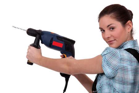 servicewoman: craftswoman holding a drill