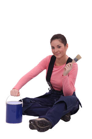 female painter holding a can and a brush Stock Photo - 15573326
