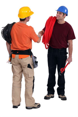 Tradesmen shaking hands in agreement photo