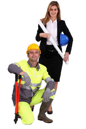 Professional woman standing next to a blue collar worker photo