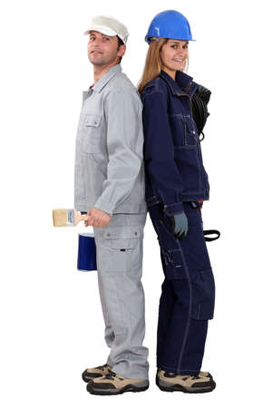 servicewoman: craftsman and craftswoman standing back to back Stock Photo