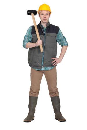 sledge hammer: Mason proudly stood with sledge-hammer Stock Photo