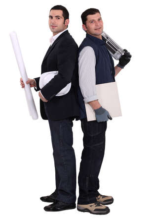 tile cutter: Architect stood with tile cutter Stock Photo