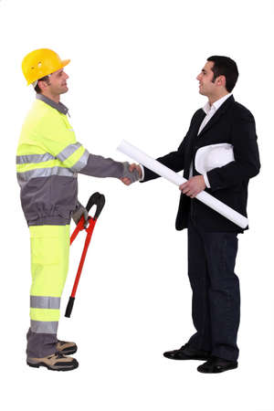 cooperate: An engineer shaking hands