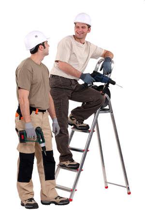 journeyman technician: Two handymen at work.