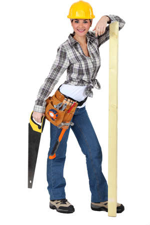 Confident female carpenter standing on white background photo