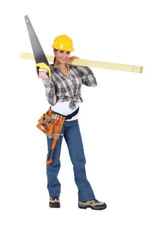 Woman carrying a handsaw and timber photo
