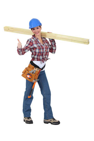 servicewoman: Woman carrying two planks of wood Stock Photo