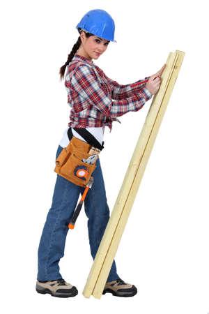 servicewoman: Female carpenter