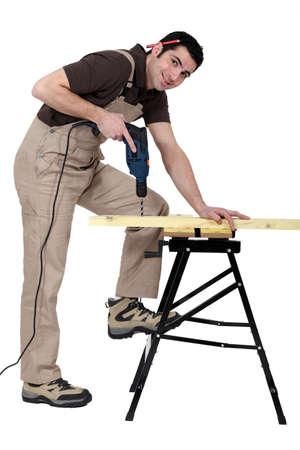 workmate: Man drilling wood