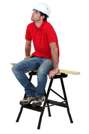 Carpenter sat on work-bench Stock Photo - 15573554