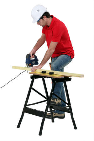 sawing: Worker sawing Stock Photo