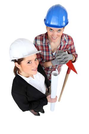 high angle shot of female architect and female bricklayer photo
