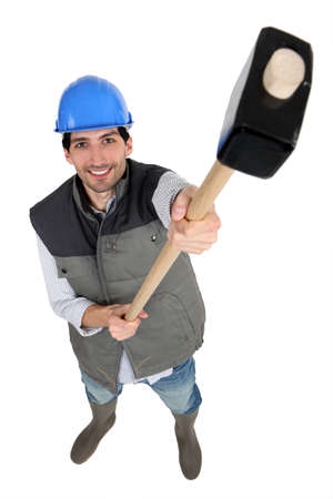Construction worker holding up a mallet photo