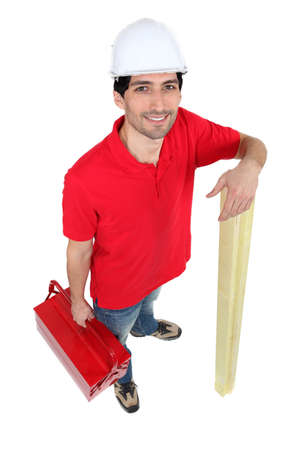 Man holding tool-box and wooden planks photo