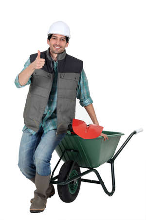 blithe: bricklayer with wheelbarrow and trowel thumb up