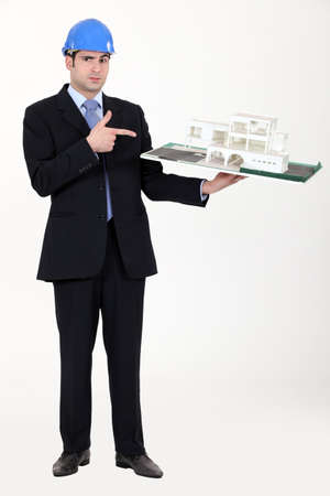 Architect pointing at his model. Stock Photo - 15573910