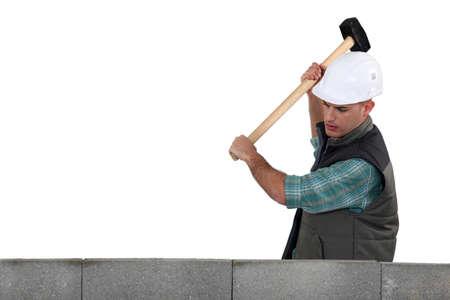 stonemasonry: Tradesman using a mallet