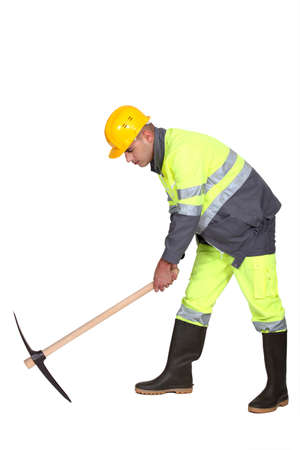 mattock: Road-worker with pick-axe