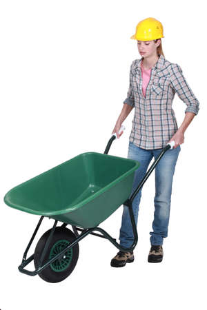 Female construction worker with a wheelbarrow photo