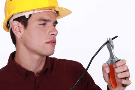 Electrician clipping wire photo
