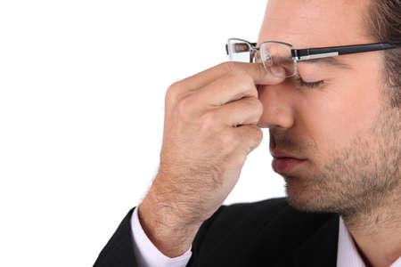 splitting headache: Stressed out businessman