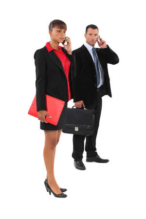 Couple of executives at the phone Stock Photo - 15573278