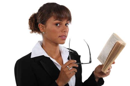 decipher: Businesswoman reading book Stock Photo
