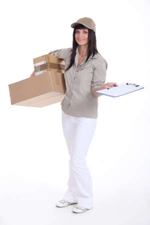 timely: Delivery woman with packages Stock Photo