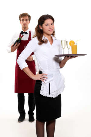 Waiter and waitress with a drinks tray photo