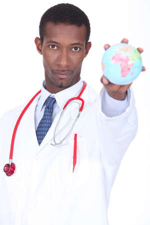 Doctor holding globe Stock Photo - 15574001
