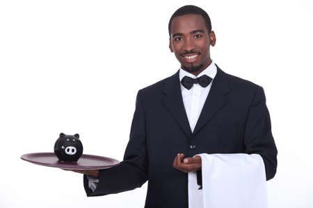 Waiter with piggy bank photo