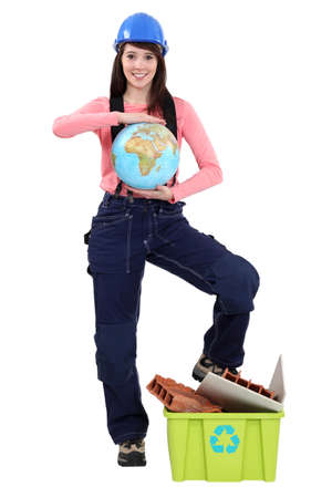 Female laborer holding globe Stock Photo - 15573472