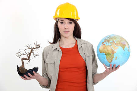 environmental awareness: Woman holding a globe and a plant Stock Photo