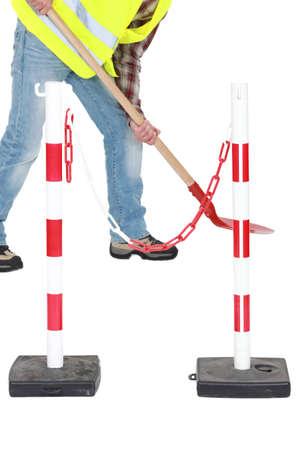 bases: Labourer shovelling during roadworks