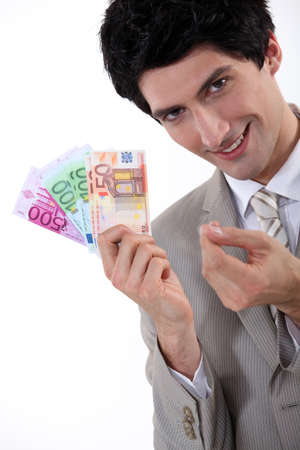 50 euro: Rich businessman showing off his money