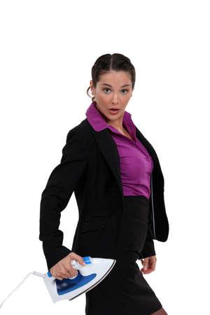 businesswoman holding iron photo