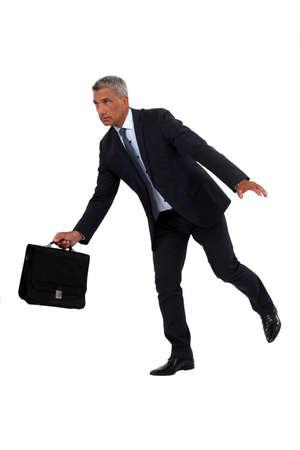 Businessman off-balance Stock Photo - 15573251