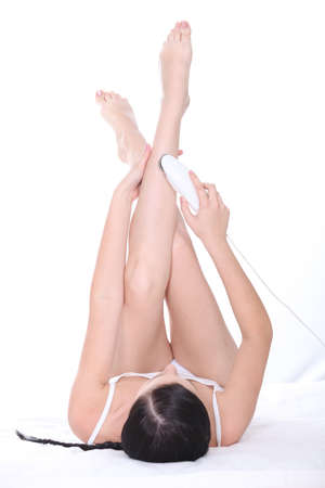 Woman depilating her legs photo