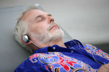 senior relaxing and listening music photo