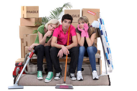 Tired roommates on moving day Stock Photo - 15574198