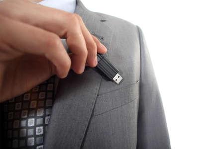 usb drive: Businessman with USB key in hand