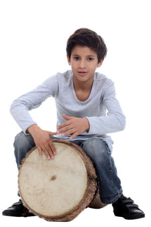 djembe drum: Boy playing a djembe Stock Photo
